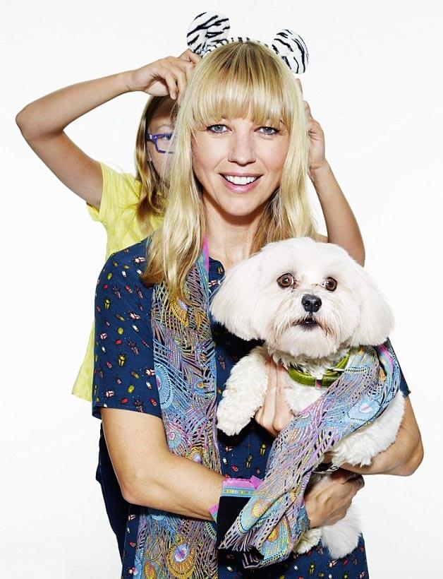 Presenter Sara Cox and daughter Lola (10) posed with her dog