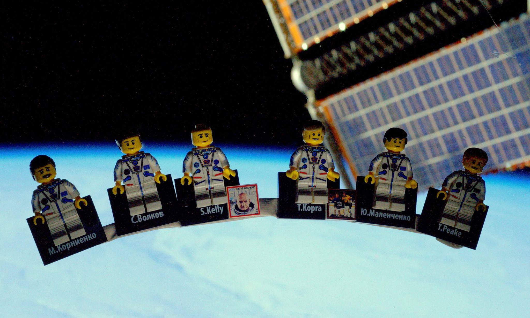 Tim Peake's fellow crew in minifigure form, pictured against a window in the ISS