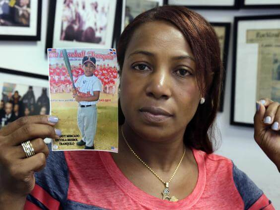 Maribel Martinez holding a photo of her 5-year-old son Andy